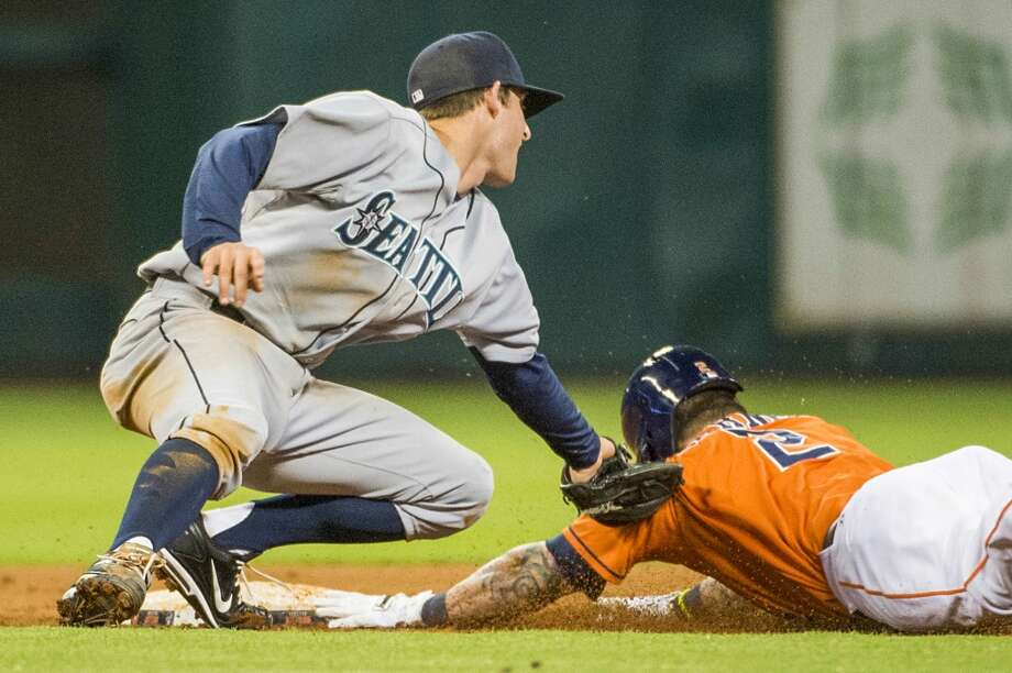 July 19: Mariners 10, Astros 7Astros center fielder Brandon Barnes beats the tag from Mariners shortstop Brad Miller for a double to complete the cycle during the eighth inning.