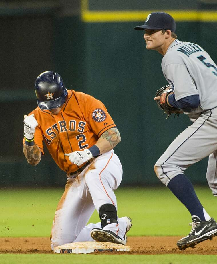 Astros center fielder Brandon Barnes pumps his fist after he beat the tag from Mariners shortstop Brad Miller to complete the cycle.
