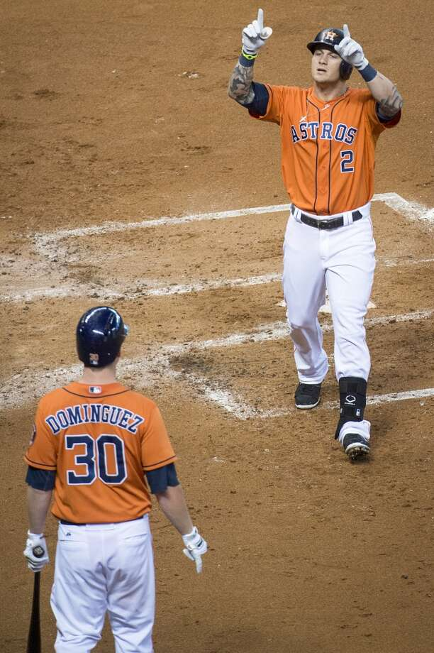 Astros center fielder Brandon Barnes celebrates after hitting a home run during the second inning.