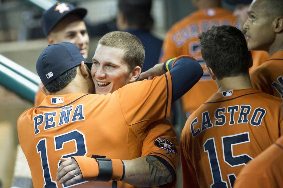 Astros center fielder Brandon Barnes gets a hug from Carlos Pena after completeing the cycle.