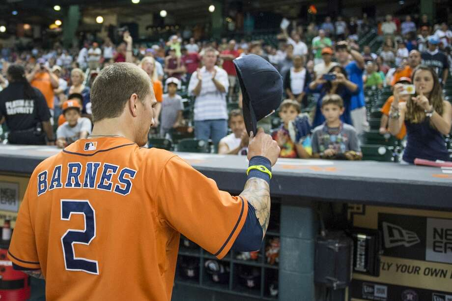Astros center fielder Brandon Barnes tips his cap to the crowd as he leaves the field after a loss to the Seattle Mariners.  Barnes went 5-for-5 and hit for the cycle.