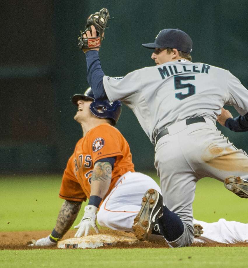 Astros center fielder Brandon Barnes looks for the call after getting past Mariners shortstop Brad Miller for a double to complete the cycle.