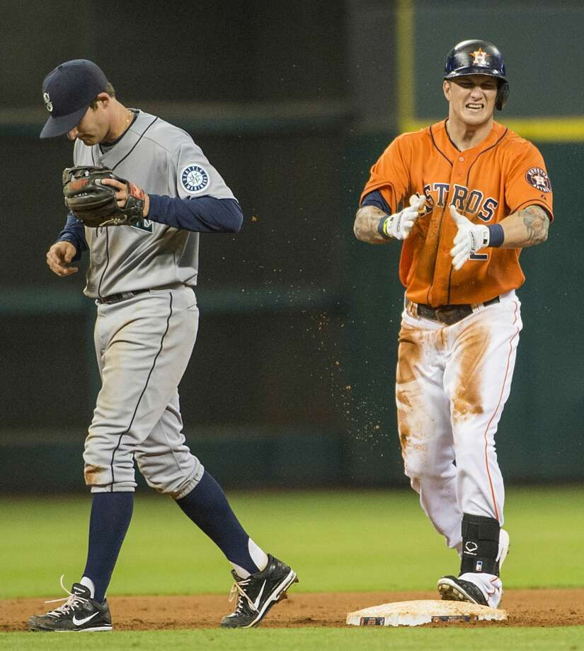 Astros center fielder Brandon Barnes celebrates after he beat the tag from Mariners shortstop Brad Miller to complete the cycle.