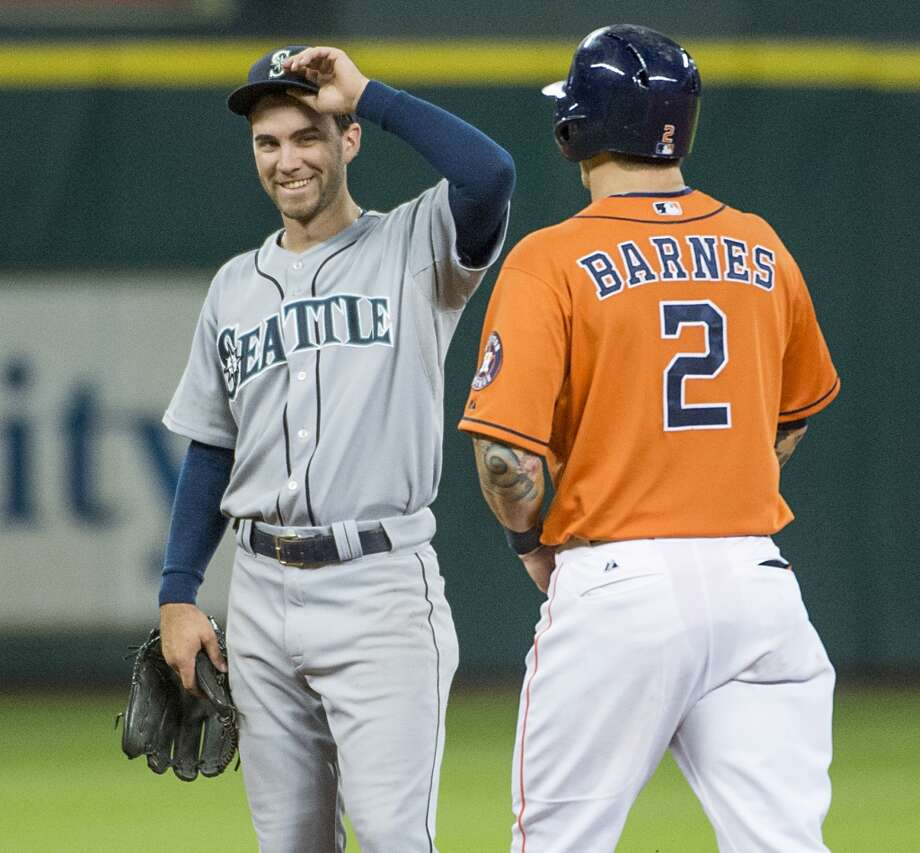 Astros center fielder Brandon Barnes gets a smile and a tip of the cap from Mariners second baseman Nick Franklin after completing the cycle.