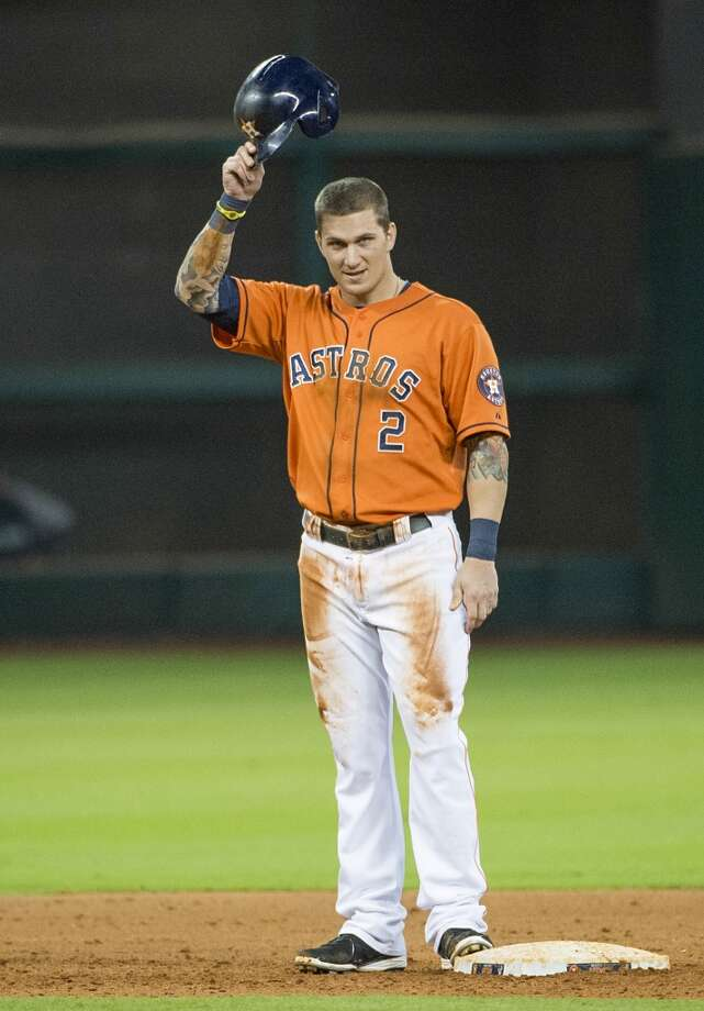 Astros center fielder Brandon Barnes tips his helmet to the crowd after he completed the cycle.