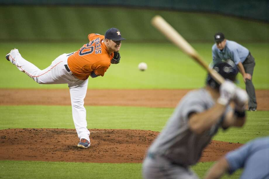 Astros starting pitcher Bud Norris pitches during the second inning.