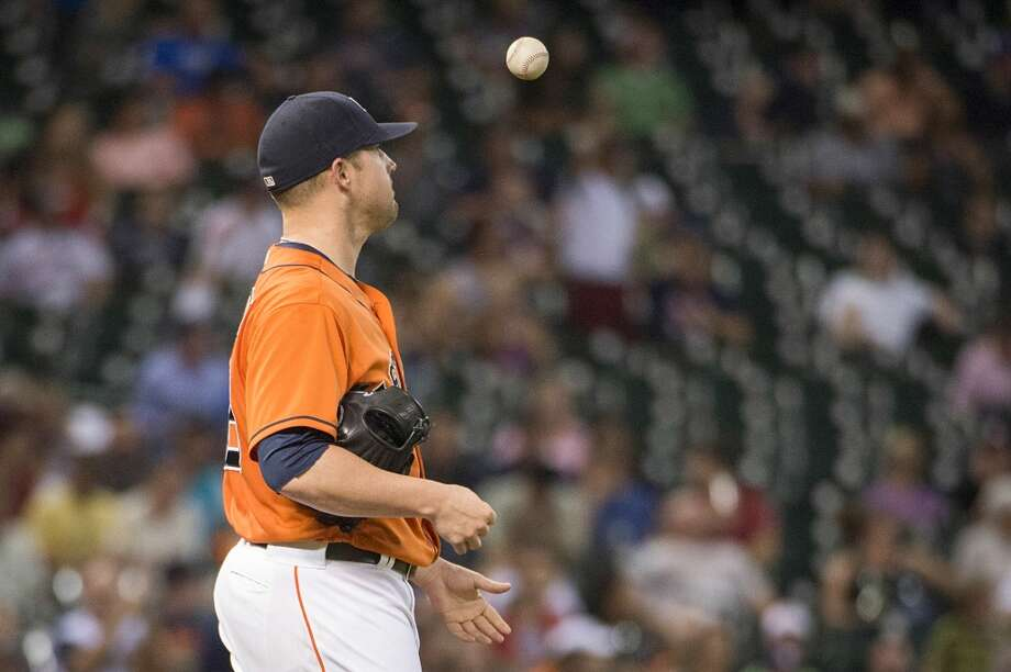 Astros starting pitcher Bud Norris tosses the ball in the air after giving up a two-run home run to Mariners third baseman Kyle Seager.