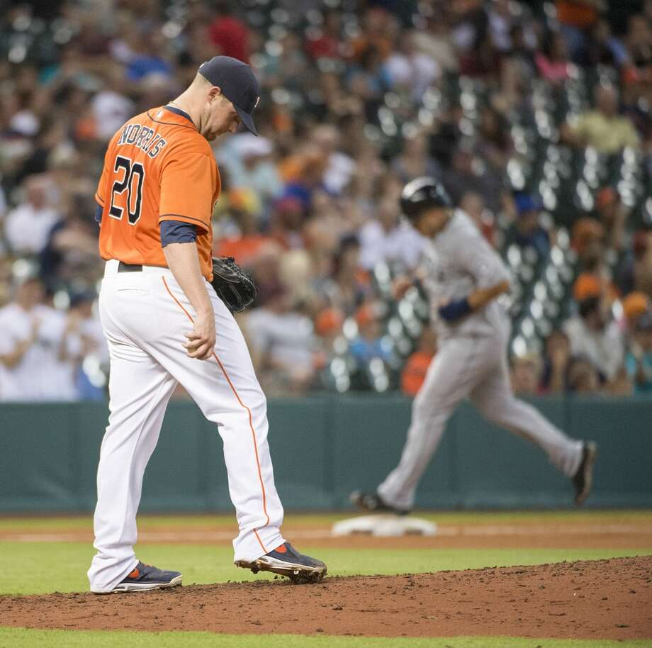 Astros starting pitcher Bud Norris kicks at the pitchers mound after giving up a two-run home run to Kyle Seager.
