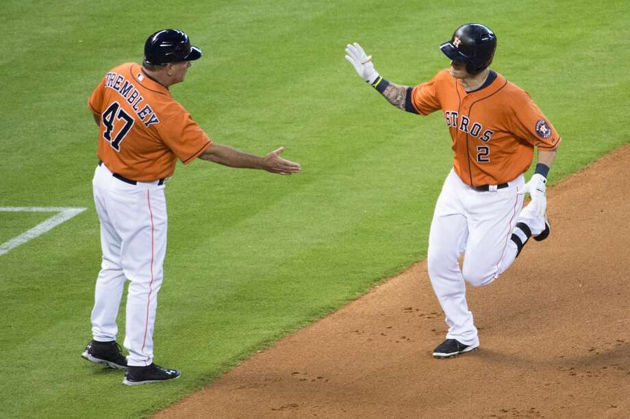 Astros center fielder Brandon Barnes gets a hand from third base coach Dave Trembley after hitting a home run during the second inning.