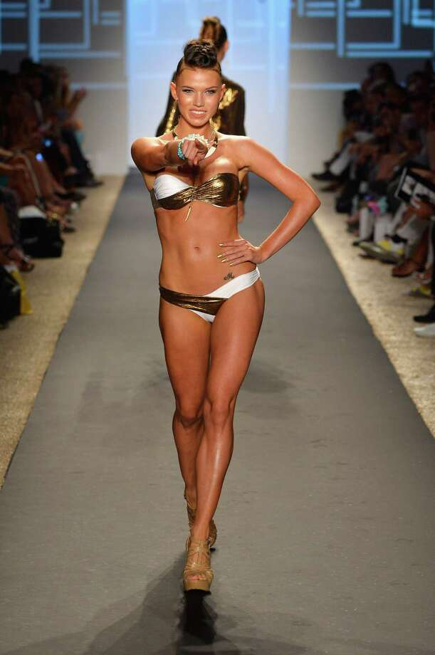 A model walks the runway at the Beach Bunny show. Photo: Frazer Harrison, Getty Images For Beach Bunny / 2013 Getty Images