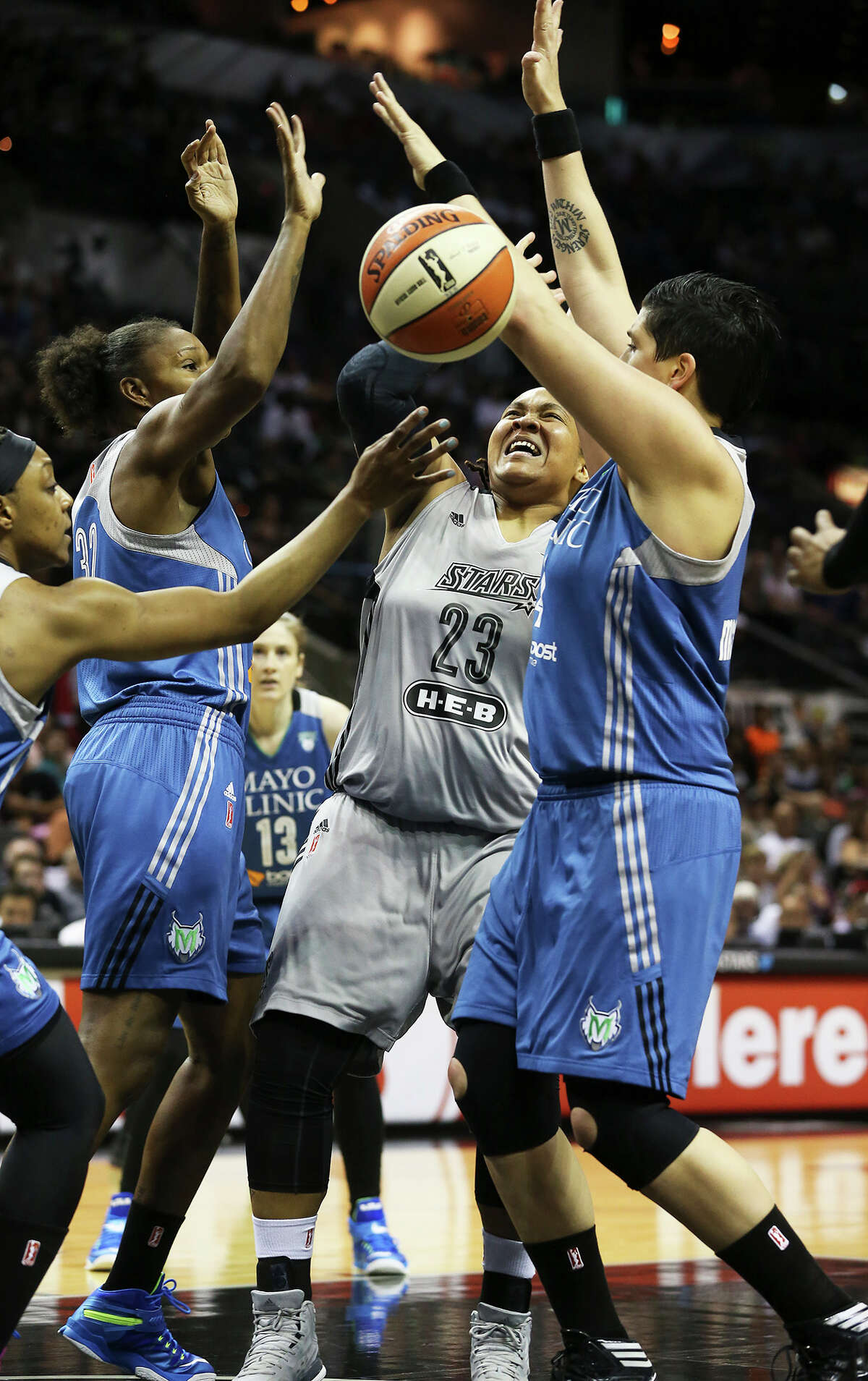 Danielle Robinson faces off against the defense of Janel McCarville (left) and Rebekkah Brunson as the Silver Stars play the Minnesota Lynx at the AT&T Center on July 19, 2013.