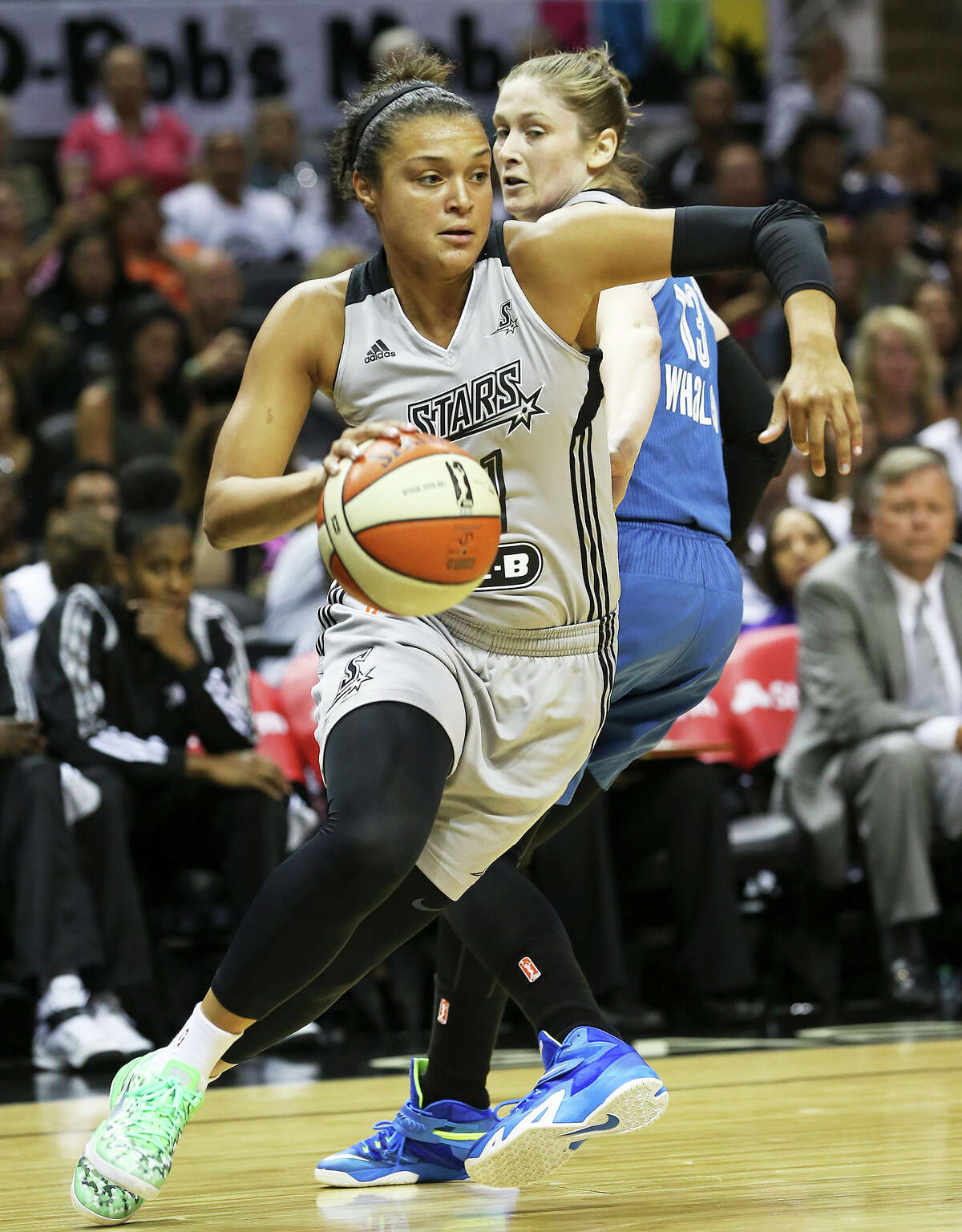 Danielle Adams is blocked under the basket by Rebekkah Brunson as the Silver Stars play the Minnesota Lynx at the AT&T Center on July 19, 2013.