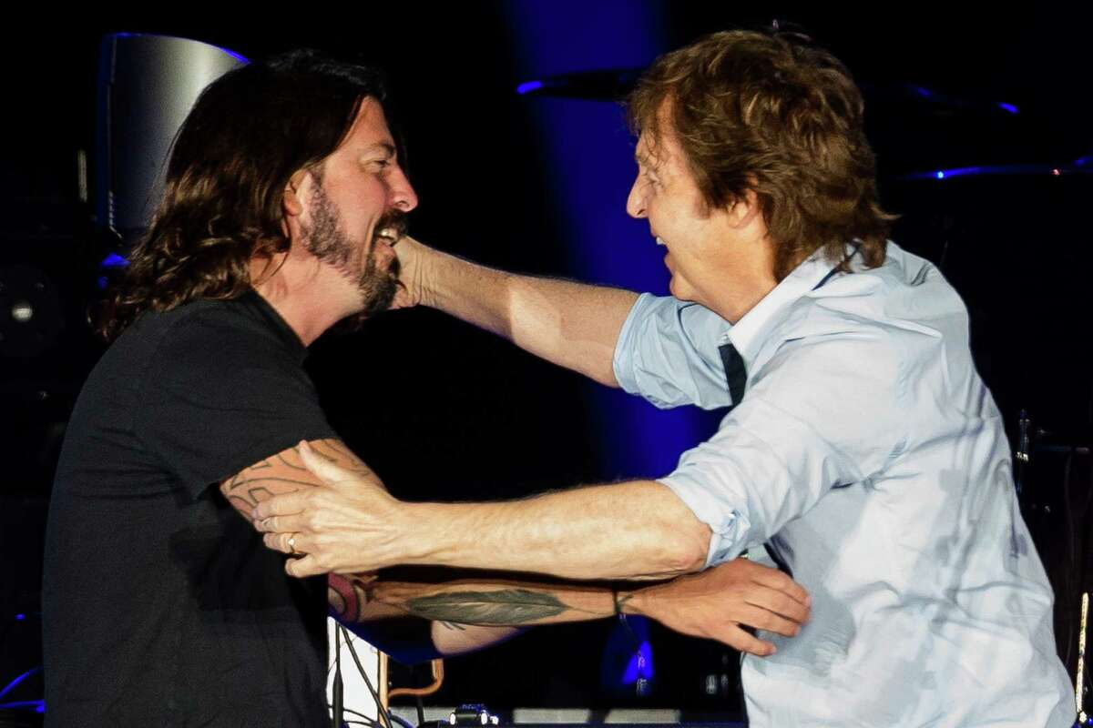 In a surprise guest section of the concert, Sir Paul McCartney greets ex-Nirvana drummer Dave Grohl in front of nearly 45,000 screaming fans during the Seattle leg of McCartney's