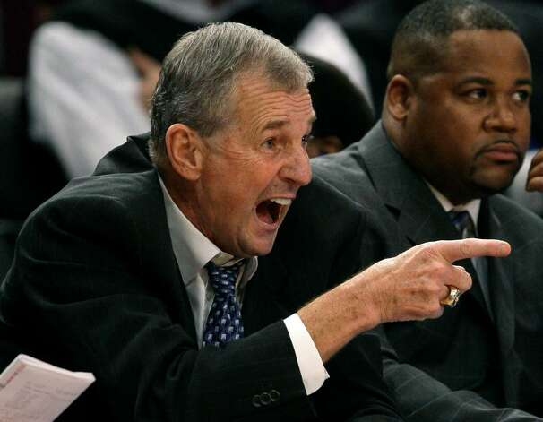 Connecticut head coach Jim Calhoun yells instructions to players during the second half against LSU in a semifinal college basketball game in the NIT Season Tip-off tournament Wednesday, Nov. 25, 2009, at Madison Square Garden in New York. (AP Photo/Julie Jacobson) Photo: Julie Jacobson, AP / AP