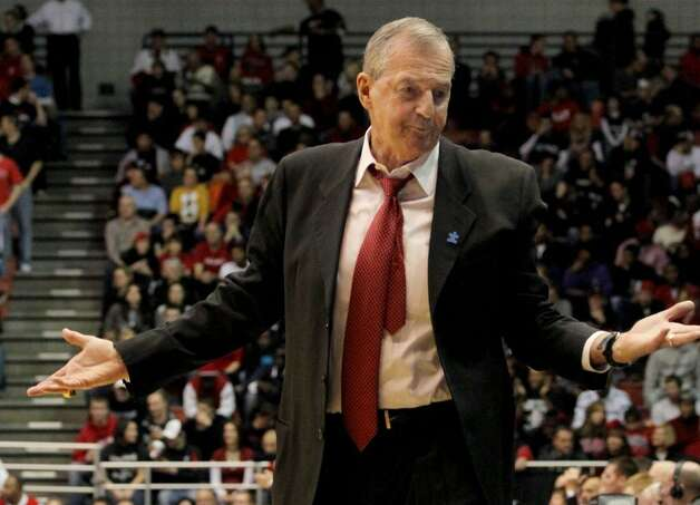 Connecticut's head coach Jim Calhoun reacts to a call from referee in the first half of their NCAA college basketball game against Cincinnati in Cincinnati, Wednesday Dec. 30, 2009. (AP Photo/Tom Uhlman) Photo: Tom Uhlman, AP / FR31154 AP