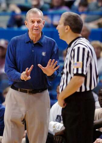 Connecticut head coach Jim Calhoun speaks with an official during the first half of his team's 106-67 victory over AIC in their NCAA college basketball exhibition game in Hartford, Conn., on Wednesday, Nov. 4, 2009. (AP Photo/Fred Beckham) Photo: Fred Beckham, AP / FR153656 AP