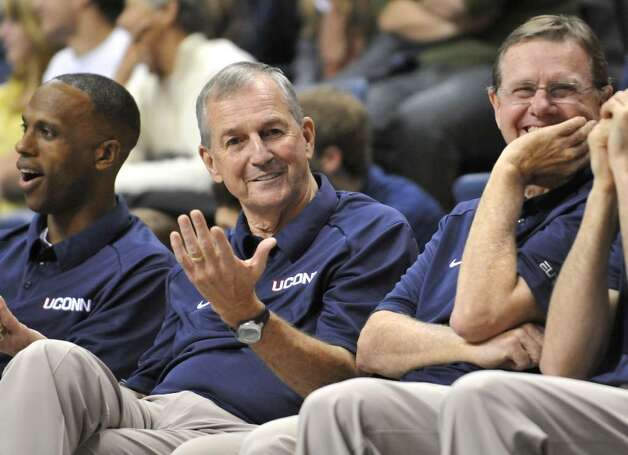 Connecticut's men's basketball head coach Jim Calhoun, center, gestures as he watches the slam dunk competition with assistant coaches Patrick Sellers, left, and George Blaney, right, at the First Night NCAA basketball exhibition, in Storrs, Conn., Friday, Oct. 16, 2009. (AP Photo/Jessica Hill) Photo: Jessica Hill, AP / FR125654 AP