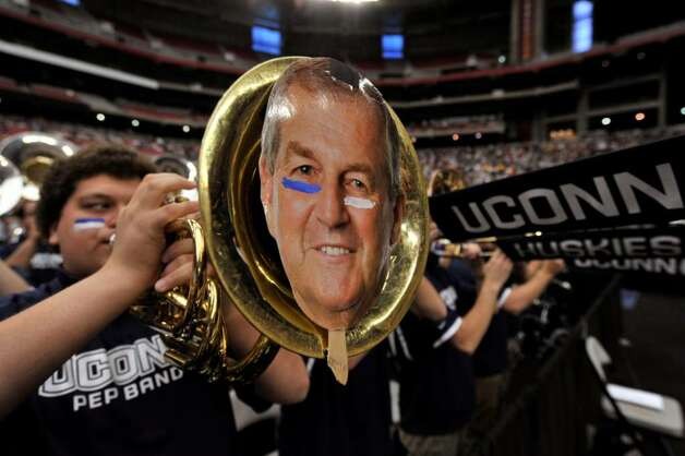 A member of the Connecticut pep band plays with a photo of Connecticut head coach Jim Calhoun is taped on the front of his instrument during the first half of a men's NCAA college basketball tournament regional final in Glendale, Ariz., Saturday, March 28, 2009. (AP Photo/Chris Carlson) Photo: Chris Carlson, AP / AP