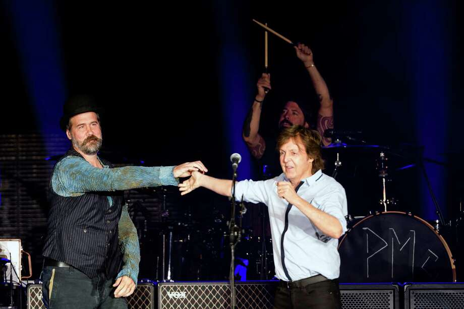 """In a surprise guest section of the concert, Sir Paul McCartney performs with all ex-Nirvana musicians Dave Grohl, Krist Novoselic and Pat Smear in front of nearly 45,000 screaming fans during the Seattle leg of McCartney's """"Out There"""" Tour Friday, July 19, 2013, at Safeco Field in Seattle. The show marked the first public concert at Safeco Field since the stadium opened in 1999. Photo: JORDAN STEAD, SEATTLEPI.COM / SEATTLEPI.COM"""