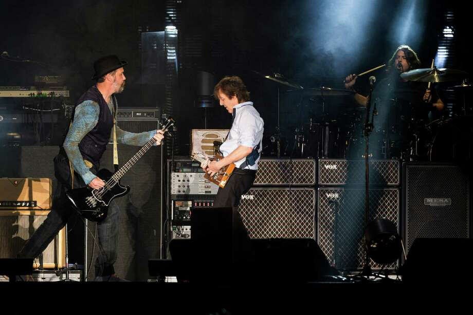 "In a surprise guest section of the concert, Sir Paul McCartney performs with all ex-Nirvana musicians Dave Grohl, Krist Novoselic and Pat Smear in front of nearly 45,000 screaming fans during the Seattle leg of McCartney's ""Out There"" Tour Friday, July 19, 2013, at Safeco Field in Seattle. The show marked the first public concert at Safeco Field since the stadium opened in 1999. Photo: JORDAN STEAD, SEATTLEPI.COM / SEATTLEPI.COM"