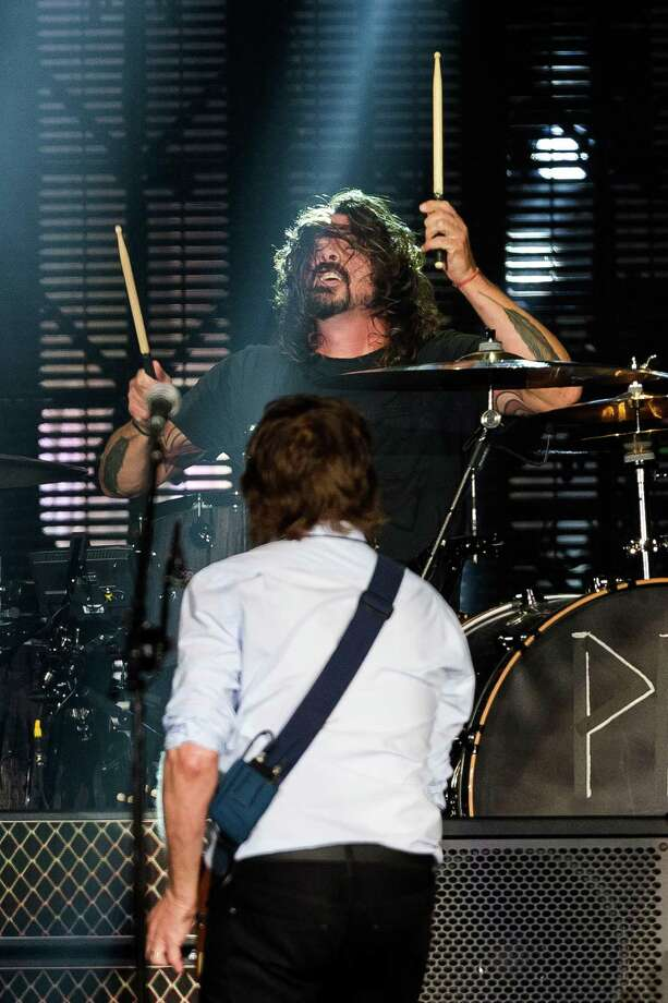 "In a surprise guest section of the concert, Sir Paul McCartney performs with ex-Nirvana drummer Dave Grohl in front of nearly 45,000 screaming fans during the Seattle leg of McCartney's ""Out There"" Tour Friday, July 19, 2013, at Safeco Field in Seattle. The show marked the first public concert at Safeco Field since the stadium opened in 1999. Photo: JORDAN STEAD, SEATTLEPI.COM / SEATTLEPI.COM"