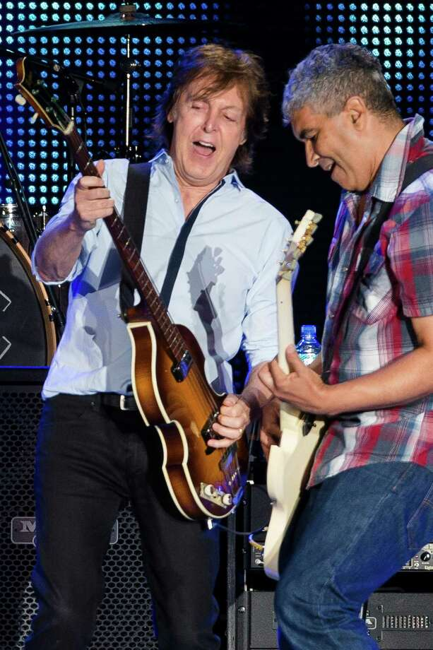 "In a surprise guest section of the concert, Sir Paul McCartney performs with ex-Nirvana guitarist Pat Smear in front of nearly 45,000 screaming fans during the Seattle leg of McCartney's ""Out There"" Tour Friday, July 19, 2013, at Safeco Field in Seattle. The show marked the first public concert at Safeco Field since the stadium opened in 1999. Photo: JORDAN STEAD, SEATTLEPI.COM / SEATTLEPI.COM"