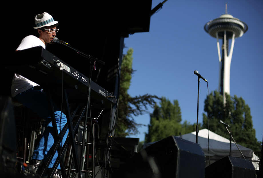 Musician Milo performs during the first day of the annual Bite of Seattle on Friday, July 19, 2013 at the Seattle Center. The event features food from dozens of local restaurants and food vendors. The Bite of Seattle runs through Sunday evening. Photo: JOSHUA TRUJILLO, SEATTLEPI.COM / SEATTLEPI.COM