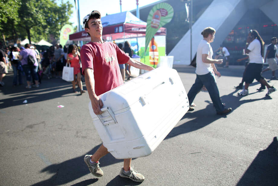Dustin Loffler of Ben & Jerry's carries a cooler during the first day of the annual Bite of Seattle on Friday, July 19, 2013 at the Seattle Center. The event features food from dozens of local restaurants and food vendors. The Bite of Seattle runs through Sunday evening. Photo: JOSHUA TRUJILLO, SEATTLEPI.COM / SEATTLEPI.COM