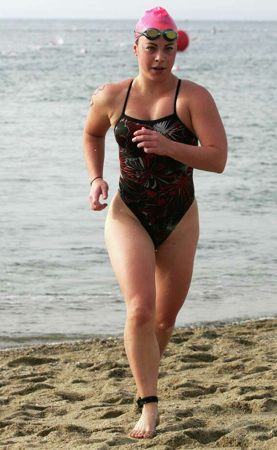 Colleen Moore, 21, from Ridgefield was the first woman out of the water at this years 26th Annual Greenwich Point One Mile Swim Saturday, July 20, 2013. Photo: David Ames / Greenwich Time Freelance