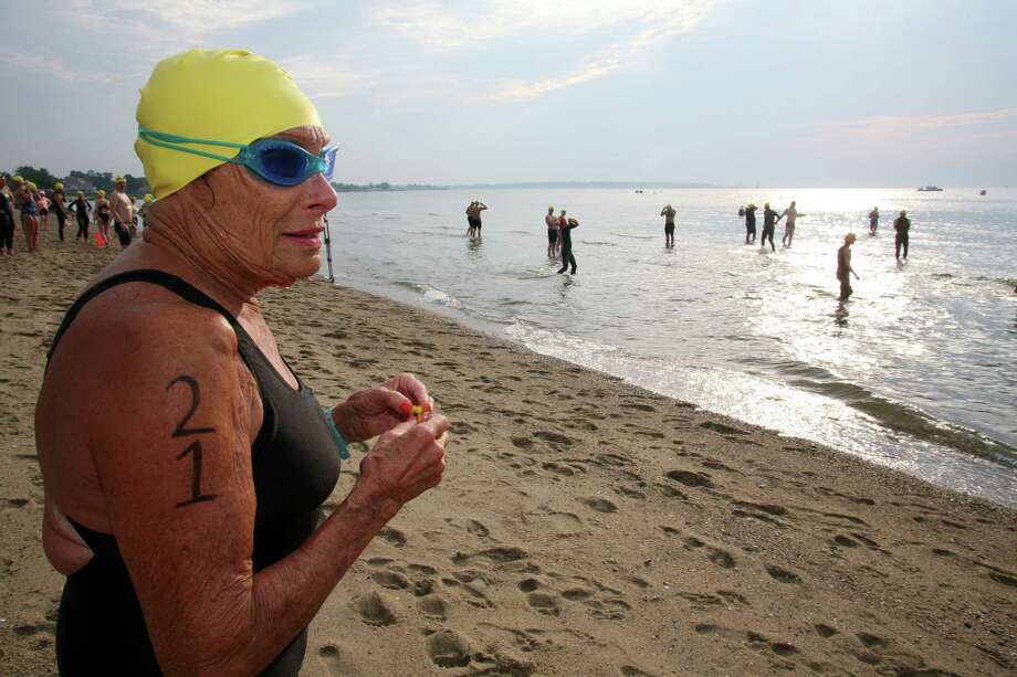 Hedy Esposito, 85, plans her strategy before the start of the 26th Annual Greenwich Point One Mile Swim Saturday, July 20, 2013. Photo: David Ames / Greenwich Time Freelance