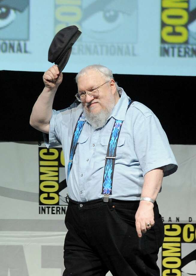 "Writer George R.R. Martin speaks onstage during the ""Game Of Thrones"" panel during Comic-Con International 2013 at San Diego Convention Center on July 19, 2013 in San Diego, California.  (Photo by Kevin Winter/Getty Images)"
