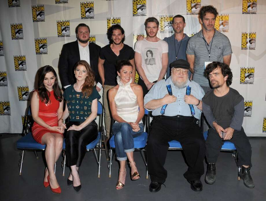 "Back row (L-R) Actors John Bradley, Kit Harington, Richard Madden, writers D.B. Weiss, and David Benioff.  Front row (L-R) Actors Emilia Clarke, Rose Leslie, Michelle Fairley, writer George R.R. Martin, and actor Peter Dinklage. during the ""Game Of Thrones"" panel during Comic-Con International 2013 at San Diego Convention Center on July 19, 2013 in San Diego, California.  (Photo by Albert L. Ortega/Getty Images)"