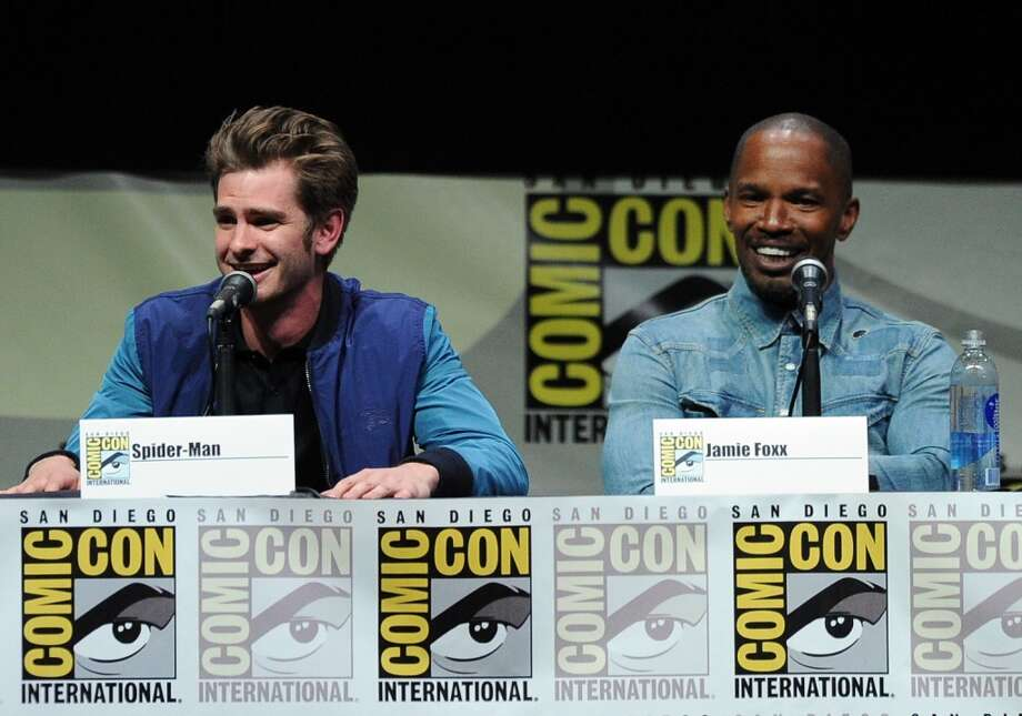 "Actors Andrew Garfield (L) and Jamie Foxx speak onstage at the Sony and Screen Gems panel for ""The Amazing Spider-Man 2"" during Comic-Con International 2013 at San Diego Convention Center on July 19, 2013 in San Diego, California.  (Photo by Kevin Winter/Getty Images)"