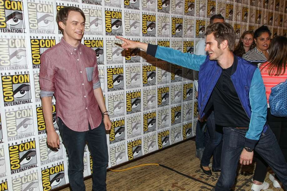 Actors Andrew Garfield (R) and Dane DeHaan attend the 'The Amazing Spider-Man 2' press line at Comic-Con International 2013 on July 19, 2013 in San Diego, California.  (Photo by Paul A. Hebert/WireImage)