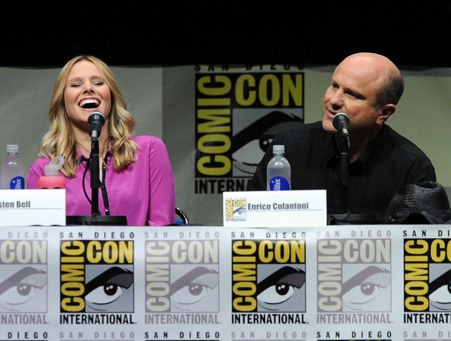"Actress Kristen Bell (L) and actor Enrico Colantoni speak onstage at the ""Veronica Mars"" special video presentation and Q&A during Comic-Con International 2013 at San Diego Convention Center on July 19, 2013 in San Diego, California.  (Photo by Kevin Winter/Getty Images)"