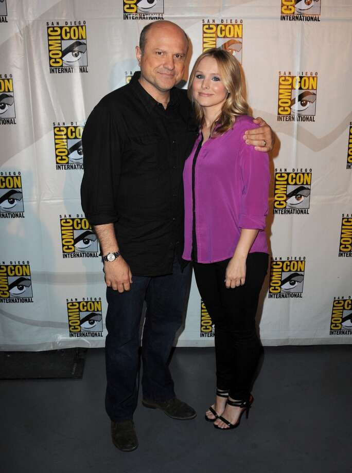 "Actors Enrico Colantoni (L) and Kristen Bell  at the ""Veronica Mars"" special video presentation and Q&A during Comic-Con International 2013 at San Diego Convention Center on July 19, 2013 in San Diego, California.  (Photo by Albert L. Ortega/Getty Images)"
