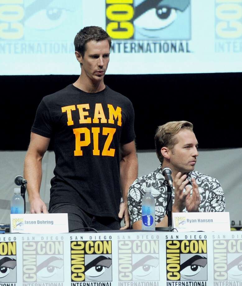 "Actors Jason Dohring (L) and Ryan Hansen speak onstage at the ""Veronica Mars"" special video presentation and Q&A during Comic-Con International 2013 at San Diego Convention Center on July 19, 2013 in San Diego, California.  (Photo by Kevin Winter/Getty Images)"