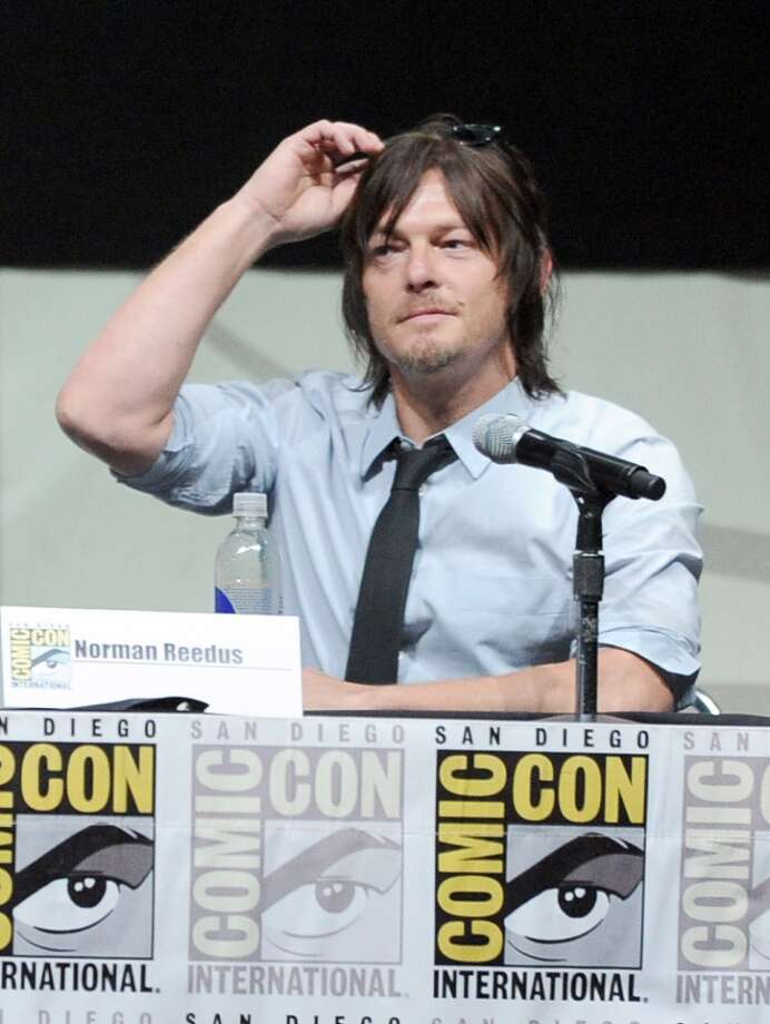 "Actor Norman Reedus speaks onstage at AMC's ""The Walking Dead"" panel during Comic-Con International 2013 at San Diego Convention Center on July 19, 2013 in San Diego, California.  (Photo by Kevin Winter/Getty Images)"