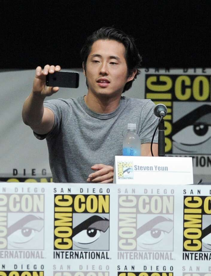 "SAN DIEGO, CA - JULY 19:  Actor Steven Yeun speaks onstage at AMC's ""The Walking Dead"" panel during Comic-Con International 2013 at San Diego Convention Center on July 19, 2013 in San Diego, California.  (Photo by Kevin Winter/Getty Images)"