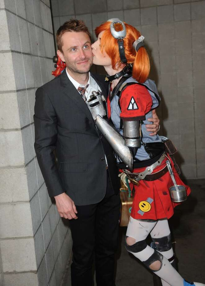Actor Chris Hardwick and a guest attend during Comic-Con International at San Diego Convention Center on July 19, 2013 in San Diego, California.  (Photo by Albert L. Ortega/Getty Images)