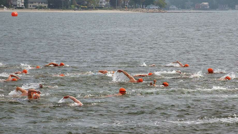 About 100 swimmers hit the water at Compo Beach on Saturday morning for the Westport Weston Family Y's annual Point-to-Point Swim.   WESTPORT NEWS, CT 7/20/13 Photo: Jarret Liotta / Westport News contributed