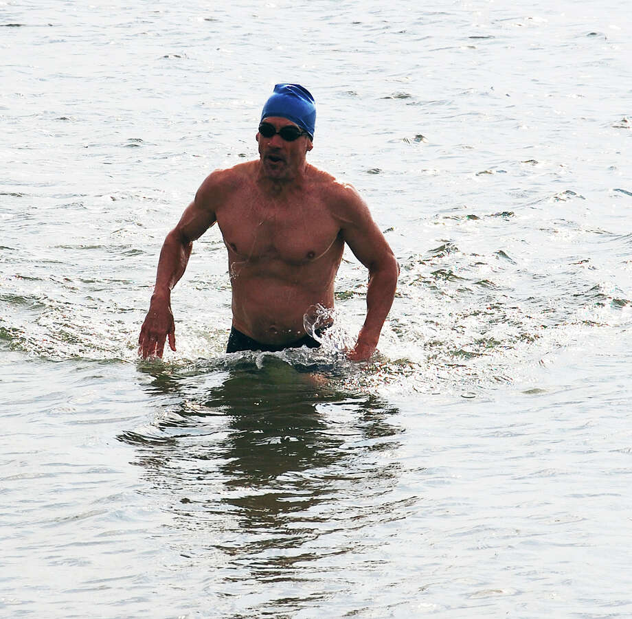Mark Loftin of New York City finished first in Saturday's Point-to-Point race at Compo Beach, finishing the mile course in just under 20 minutes.  WESTPORT NEWS, CT 7/20/13 Photo: Jarret Liotta / Westport News contributed
