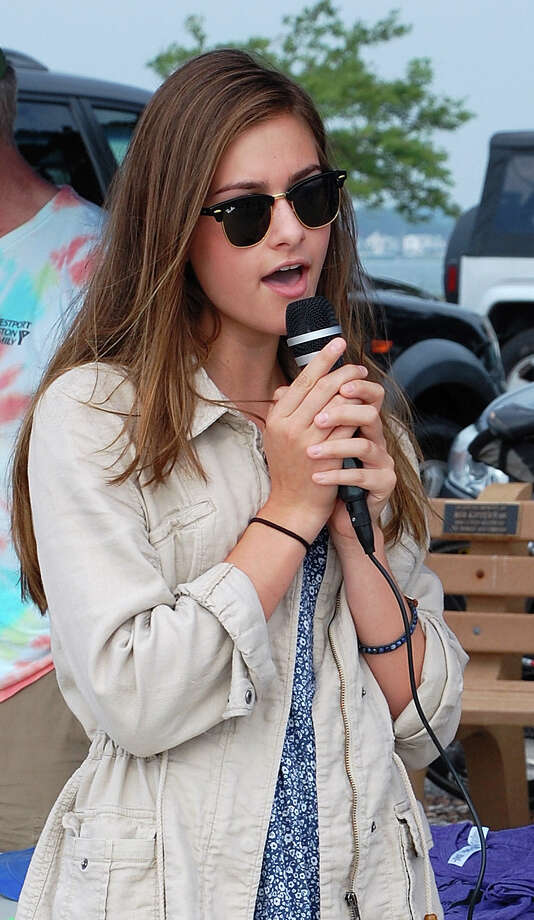 "Noa Wind of Westport revived the tradition of singing ""America the Beautiful"" at Saturday's Point-to-Point Swim at Compo Beach.  WESTPORT NEWS, CT 7/20/13 Photo: Jarret Liotta / Westport News contributed"