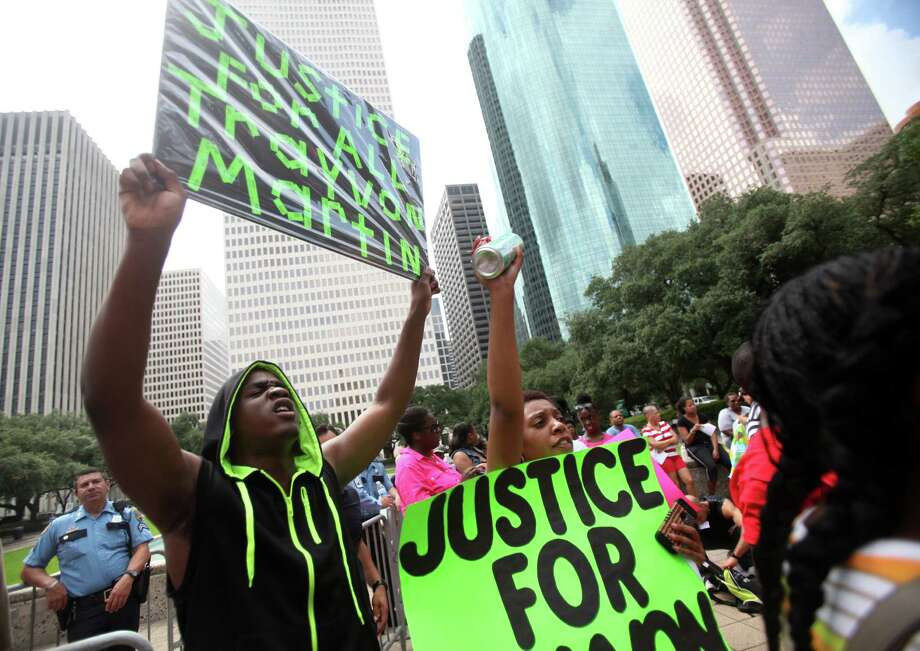 (Left) Larry Ruffin, 18, joins the peace protest for Trayvon Martin at City Hall on Saturday, July 20, 2013, in Houston.  Reverend Al Sharpton and the National Action Network (NAN) organized a national day of peaceful protest for 100 U.S. cities in response to the unjust verdict in the George Zimmerman trial. Photo: Mayra Beltran, Houston Chronicle / © 2013 Houston Chronicle