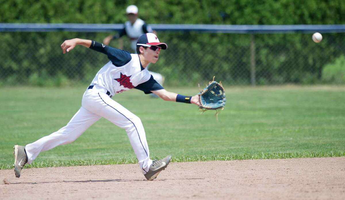 Westport's Ricky Offenberg makes a catch during Saturday's Little League Section 1 tournament game against Orange at Frank Noto Field in West Beach Park in Stamford, Conn., on July 20, 2013.