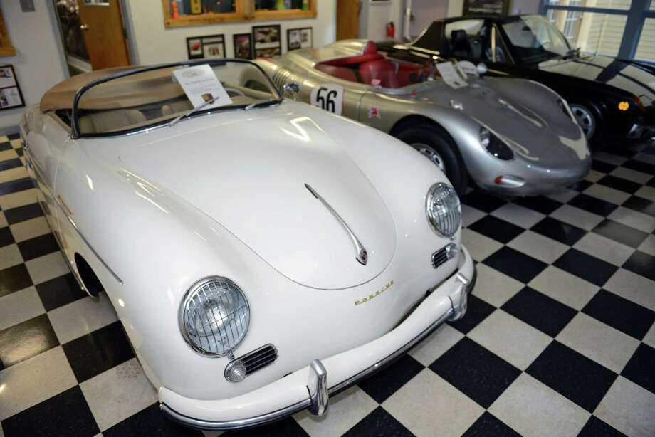 "This 1955 Porsche Speedster, previously owned by Nicolas Cage, was on display along with the rest of Dr. Jack Gish's Porsche collection at JLG Autocrib in Brookfield, Conn. on Saturday, July 20, 2013.  Larry Kosilla, founder of AMMO NYC auto care, gave car detailing demonstrations.  Gish has 32 Porsches in his collection, ranging from the 1950s through the 2000s, including a car previously owned by Nicolas Cage and a car driven by Bruce Willis in the 1992 film ""Death Becomes Her."" Photo: Tyler Sizemore / The News-Times"