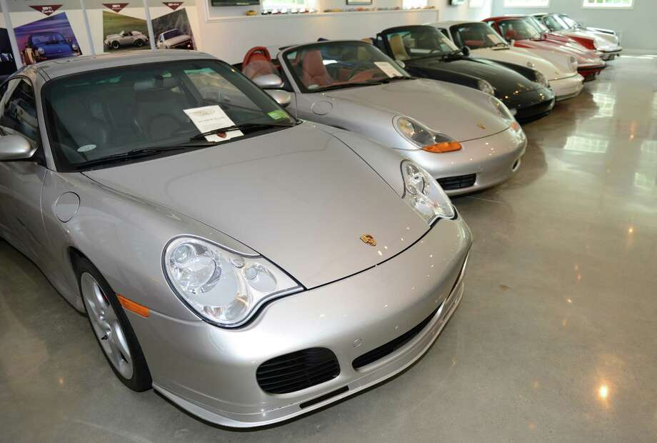 "The 2003 Porsche 996 Turbo is the newest in Dr. Jack Gish's Porsche collection, which was on display at JLG Autocrib in Brookfield, Conn. on Saturday, July 20, 2013.  Larry Kosilla, founder of AMMO NYC auto care, gave car detailing demonstrations.  Gish has 32 Porsches in his collection, ranging from the 1950s through the 2000s, including a car previously owned by Nicolas Cage and a car driven by Bruce Willis in the 1992 film ""Death Becomes Her."" Photo: Tyler Sizemore / The News-Times"