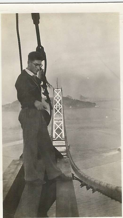 Ray Fross, S.F. daredevil, atop a Bay Bridge tower in 1935, joined by a friend who snapped this photo. Photo: Tom Devine, Courtesy Robin Fross