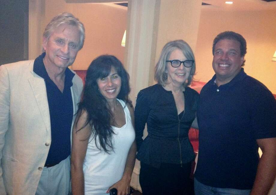 "Michael Douglas, Suzanne Gabriele, Diane Keaton and Danny Gabriele chum it up after shooting the romantic comedy ""And So It Goes"" at Gabriele's Italian Steak House in Greenwich on Tuesday evening. Photo: Contributed Photo"