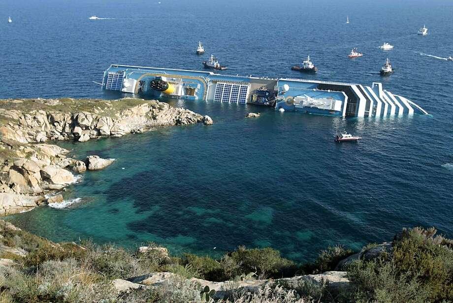 The cruise ship Costa Concordia ran aground at the tiny Tuscan island of Giglio, killing 32 people. Photo: Gregorio Borgia, Associated Press